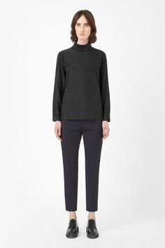 Made from pure silk with a smooth, crisp finish, this long-sleeved top has a raised rolled neckline. A loose, relaxed fit, it has a softly curved hemline and back button fastening for a clean front.