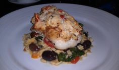 Crab encrusted Black Grouper with tomato, olive, swiss chard orzzo salad.