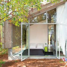 A green French vacation house shared by two couples.