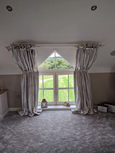 Apex window with straight pole to hold the curtains at the top, and French pole to keep them close to the wall. By Simply Soft Furnishings by Julie Hughes.