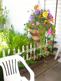 Front Porch, main house, hanging flower arrangement by Heidi's Swiss Floral.  (Prospect Valley Hospitality renovated historic 1872 property, Wheat Ridge, Colorado, USA)