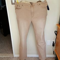 DG2 5 pocket tan Slimmer jeans Cotton polyester rayon spandex blend 5 pocket jeans. Rivet embellishments around front pockets. Tummy Slimmer material inside. Inseam 29 inches. Brand new with tags and never worn. Diane Gilman Pants Straight Leg