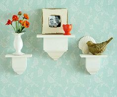 Glue wood on top of crown-molding divider blocks and paint them to create these miniature shelves.