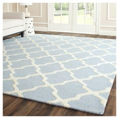 Brighten up your space with a Safavieh Maison Textured Area Rug. This stylish rug makes a statement with a modern, oversized twist on the classic trellis pattern in light blue and ivory.
