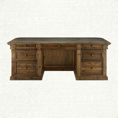 CORBEL EXECUTIVE DESK IN BARNWOOD BROWN SKU: 55COREXDKKT Available in mid-July. $4,999.00 SALE $3,499.00 The corbel desk is inspired by a bar counter one of our vendors had at a party. We liked it so much we asked him to turn it into a desk, including the rounded corners on the front, zinc top, and decorative corbels supporting the top for which it is named. It all comes together with rustic appeal and ample storage possibilities.
