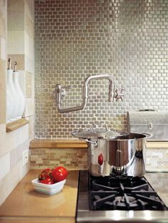 Popularized by TV chefs and restaurant-based reality shows, features common to gourmet kitchens are becoming desirable amenities for at-home cooks too. Pot-filler faucets, for example, fill the bill for convenience as well as style. Instead of toting heavy water-filled pots from the sink, cooks can simply fill 'er up at the cooktop. Integrated into the wall, this faucet shimmers against a backdrop of glass tile.
