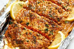 Baked Honey Garlic Salmon in Foil — Sweet and tangy flavors shine in this bright seafood dinner. A whole salmon fillet coated in honey mustard garlic sauce gets baked in foil and broiled to a flak… Salmon In Foil Recipes, Fish Recipes, Seafood Recipes, Cooking Recipes, Healthy Recipes, Lemon Recipes, Honey Salmon, Garlic Salmon, Hardboiled