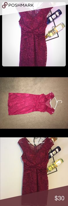 Pretty Ruby Red lace dress Purchased for a holiday party wore for 2 hours total. Excellent condition! Very pretty lace design. Silky slip underneath hugs your body and fits perfectly in all the right spots 🤗 Dresses Midi