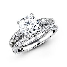 Runway Collection <3 This gorgeous 18K white engagement ring and band is comprised of 1.26ctw round white Diamonds. LP1973