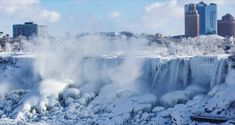The polar vortex has turned Niagara Falls into a spectacular winter wonderland as it bears down on the Northeast. Temperatures dropped to in Ontario, Canada, on Thursday. Niagara Falls Frozen, Frozen Photos, Weather Words, American Falls, Strange Photos, The Weather Channel, Extreme Weather, Fire And Ice, Global Warming