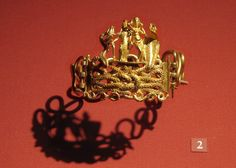 "Bracelet with Agathodaimon, Isis-Tyche, Aphrodite, and Terenouthis; gold. Roman Period, Egypt, 1st century BC-1st century AD. ""Powerful talismans of fertility and good destiny are woven into this rich golden composition. The bodies of two snakes intertwine to form a Herakles knot, the centerpiece of this bracelet. The snake represents Agathodaimon, & the cobra represents  Terenouthis, two deities associated with Serapis & Isis. Between them stand 2 goddesses, Isis-Tyche, and Aphrodite."""