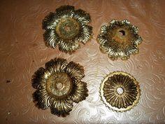 Foglia oro applicata su lega metallica