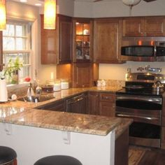 Small Kitchen Remodel...similar to our kitchen....thinking I may want to paint the cabinets white instead to enlarge the room and bring in light