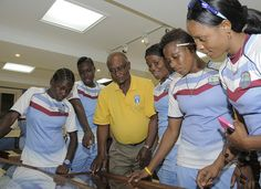 Cammie Smith talks about a piece of memorabilia with Shemaine Campbell, Shamilia Connell, Sabrina Munroe, Natasha McLean and Merissa Aguilleira during a tour of the Legends of Barbados Museum.