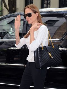 Angelina Jolie steps out of her car on the Upper East Side on May 12, 2014 in New York City, New York. YSL Cassandra Leather Shoulder Bag
