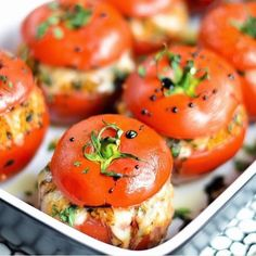 Caprese-Style Stuffed Tomatoes with Balsamic Reduction 1 c. balsamic vinegar 8 vine ripened tomatoes, about 2-3 inches in diameter 1 1/2 t. sugar kosher salt & pepper 4 T. extra-virgin olive oil 1 c. couscous 2 cloves of garlic, minced 1/8 t. red pepper flakes 1 T. fresh lemon juice 1 c. finely chopped basil 3/4 c. plus 2 T. fresh grated Parmesan cheese 8 oz. mozzarella cheese, 1/2 c. shredded, the rest cut into 1/2-inch dice
