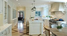 Another great kitchen. Love the wood and travertine? Marble? Floor.