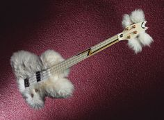 """""""It kinda looks like a mad scientist from an hairband fused a poodle and a bass together. Lego Guitar, Cool Guitar, Dean Bass, Dean Guitars, Bass Guitars, Pat Metheny, Famous Guitars, Steve Vai, All About That Bass"""
