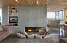 I like this - fireplace and tv on one wall but still looks good
