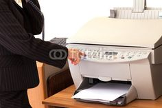 Sold at Fotolia: Secretary Using Printer