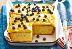 A light and fluffy vanilla cake with a creamy custard frosting, topped with fresh, juicy  blueberries - you'll be wanting more than one slice!