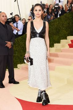 The Fashion-Tech Looks From The Met Gala  #refinery29  http://www.refinery29.com/2016/05/109782/best-dressed-met-gala-2016#slide-31  Selena GomezSelena Gomez gave a Louis Vuitton slip dress some edge with a structured leather bustier and heavy-soled black boots with contrasting laces. It's not the most glam red-carpet look we've seen the starlet step out in, but we appreciate the amount of celebs that left the blister-inducing shoes at home in favor of some more practical footwear (New York…