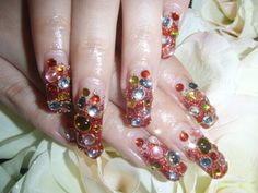 Cool, but this person, obviously has no job... you wouldn't be able to work with nails like that.