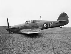 Hurricane Mk I TM-L lies abandoned in a field near Rollesby Road at Martham on 2 April 1940. Flying Blue 2 in the early morning on detachment from RAF Wattisham, F/O David Phillips of No 504 Squadron RAF attacked a He 115 southwest of Terschelling Bank, while the rest of the section was compelled to turn for home due to fuel shortage. Closing to 100yds, he inflicted serious damage to the reconnaissance seaplane but took serious hits from return fire, including a bullet in the thigh.