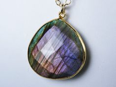 Hey, I found this really awesome Etsy listing at https://www.etsy.com/listing/215301407/purple-labradorite-necklace-large-flashy