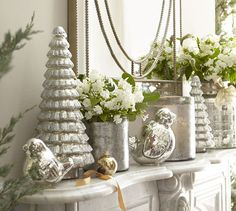 Decorate with silver leaf hurricanes for a #winter wedding.