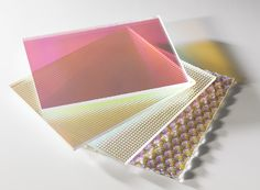 Plexiglas Radiant is an eye-catching combination of a textured surface with a rainbow effect made of PMMA.  The special Radiant surface coating is available in three different textures: Honeycomb, Ribbed or Pyramid texture. The textured surface diffuses light in an interesting way while colours change according to the viewing angle. This is known as the 'Radiant Effect'. Those passing by see  a colorful play of hues that is set off to particular advantage by the surface texture.