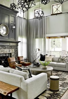 Add more natural wood (shiplap accent, exposed brick and/or industrial pieces).... But, love Neutral colors, mix of dark & light, stone fireplace with deep gray above, unique hanging lights, wrought iron, lots of seating