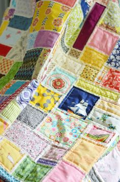So. I made a quilt. A soccer quilt. The perfect kind to put on the grass and enjoy many a kick. It has scraps from about a million projects, and when I pull it out of the wash and the edges are all...