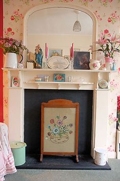 Firescreen with ebroidery in fake fireplace