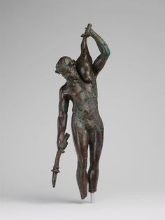 Bronze statuette of a satyr with a torch and wineskin via Greek and Roman Art Medium: BronzeRogers Fund, 1941 Metropolitan Museum of Art, New York,.