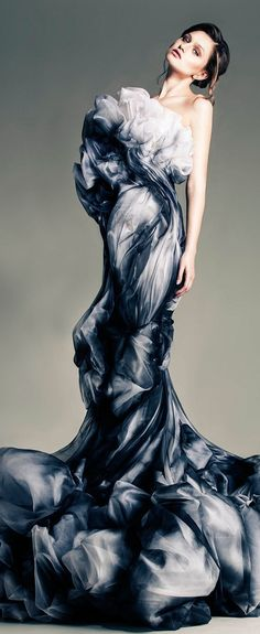 MOVEMENT. The eyes move from top to bottom almost as if the dress was made to look like a waterfall.