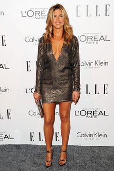 Jennifer Aniston wears a Kaufmanfranco dress, and Balenciaga shoes.