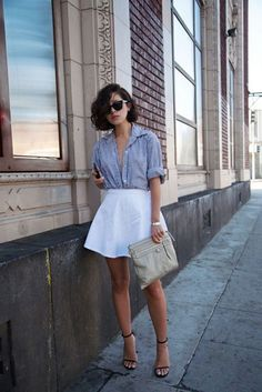 Shop this look for $88: http://lookastic.com/women/looks/blue-button-down-shirt-and-white-skater-skirt-and-grey-clutch-and-black-sandals/1887 — Blue Vertical Striped Button Down Shirt — White Skater Skirt — Grey Leather Clutch — Black Sandals