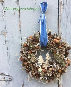 This pine cone wreath would look nice all year long. It is made with 5 different kinds of pine cones. Acorns, Moss, Birch bark and Statice. I cut out some trees out of White birch bark and attached a Birch Christmas Tree, Christmas Crafts, Christmas Decorations, Christmas Ornaments, Floral Decorations, Natural Christmas, Christmas Design, Xmas Tree, Winter Christmas