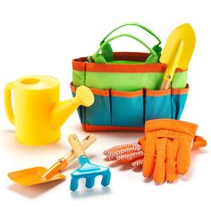 """Growing up a gardener!A kid-size multi-piece gardening tools with a small tote to store them all in, so they can be a pro garden guru like you! Comes with 6 gardening tools to dig, rake, and water in their own garden or potted plants.FEATURES•6-piece gardening set with tote• Comes with gloves, 3 tools, and a watering can•Ages 3 and up•Tote (11"""" x 6"""") and 3 metal tools (approx. 6"""" each)MATERIALS• Gloves and tote: Polyester•Tools: Met..."""
