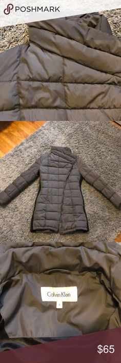 Calvin Klein Funnel Neck Puffer Coat Great condition funnel neck puffer coat. Gray with Black stretch side panels. Hidden zip pockets.  Only signs of wear are rips on the inside of the pockets. Great condition otherwise. No stains, rips or tears. Offers welcome. Calvin Klein Jackets & Coats Puffers