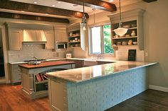 """lovely kitchen. U shaped layout. Center island. Room for stools at counter. So people can hang at counter and be """"in"""" the kitchen, but not underfoot while cook is working. This is perfect"""