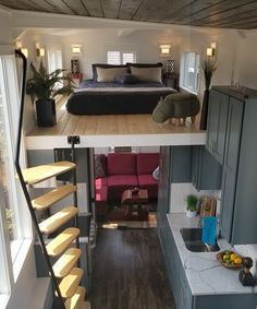 Bachelor by Tiny Mountain Houses - Tiny Living The main floor flex room can be used as a bedroom den/office or living room. Above the flex room is the main loft with pine tongue-and-groove flooring. Tiny House Loft, Best Tiny House, Tiny House Living, Tiny House Plans, Tiny House Design, Tiny House On Wheels, Tiny Houses, Tiny Loft, Tiny House Office