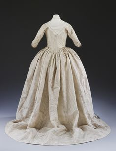 Back view of the wedding dress worn by Sarah Boddicott for her wedding in 1779 © V&A Collection