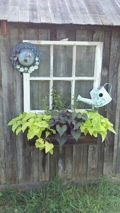 Spruced up the side of our wellhouse reusing an old window and a flower box i made from cedar fence panels.