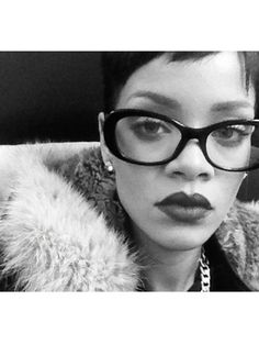 For a more retro vibe, pick a pair of squareish ovals like RiRi's glasses! Even though this pic is black and white, we can tell that the dark lip definitely helps complete her vintage-inspired look.   - Seventeen.com