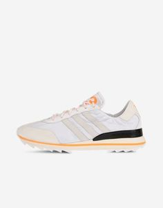 Y-3 Rhita reimagines the iconic adidas SL72 running shoe with luxe materials and colour-pop accents. Upper: nylon with nappa leather accents on heel and toe. Lizard-embossed leather 3-Stripes. Soft patent leather quarter. Lining: mesh and leather.