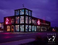 roger wade studio commercial architectural photography of glass and steel brewery at twilight, great northern brewing company, whitefish, montana, by ehdd architecture