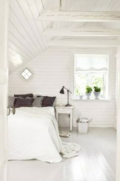 painted boards - fresh white bedroom. Looking for classic white bedding and solid wood beds? Try www.naturalbedcompany.co.uk