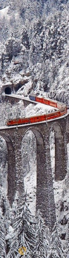 A train moves swiftly through Graubunden, Switzerland just like a scene of the train traveling to Hogwarts in Harry Potter.